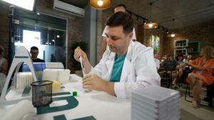 Filling microplate with special liquid Buffer-X and pipette at Formula-X pipetting skills contest