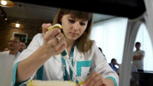 Ivanna Gaibonuk 1st place winner filling microplate with pipette at Formula-X Lviv 2019 pippeting skills contest