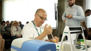 Yurii Lebedin filling microplate with pipette at Formula-X Lviv 2019 pippeting skills contest