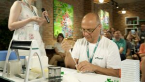 Yurii Lebedin shows pipette technique on demonstration of rules for Formula-X Lviv 2019 pippeting skills contest